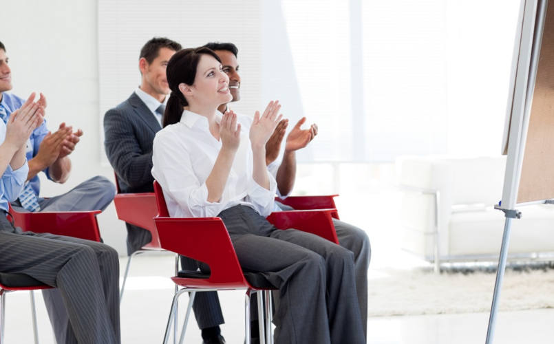 Multi-ethnic business people clapping at the end of a conference